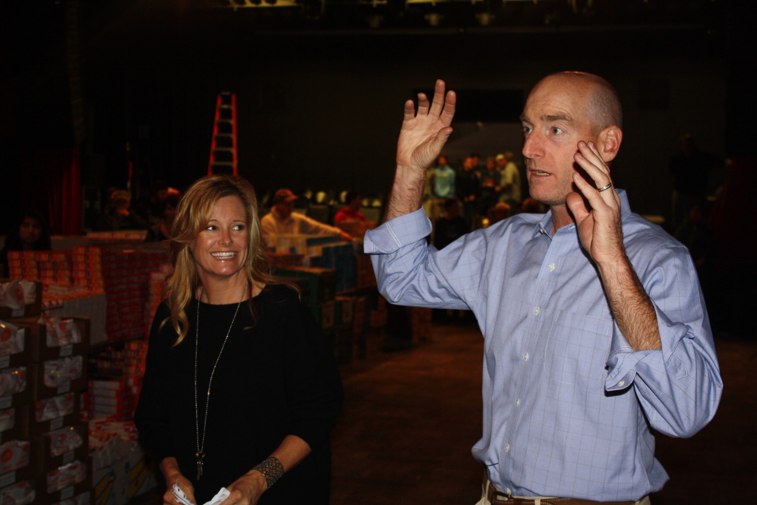 Tabitha and Jim Furyk address and thank the group of volunteers prior to the beginning of the packing process.