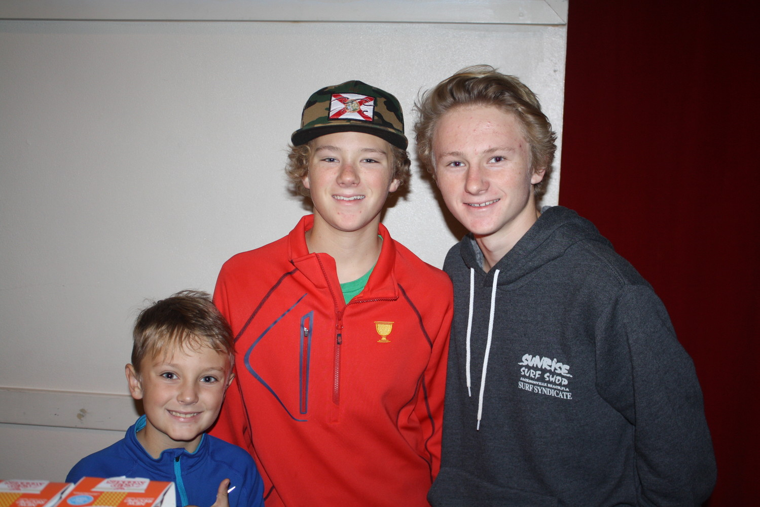 "Barett, Tyler and Taggert Dryden help pack bags at ""Hope for the Holidays."""