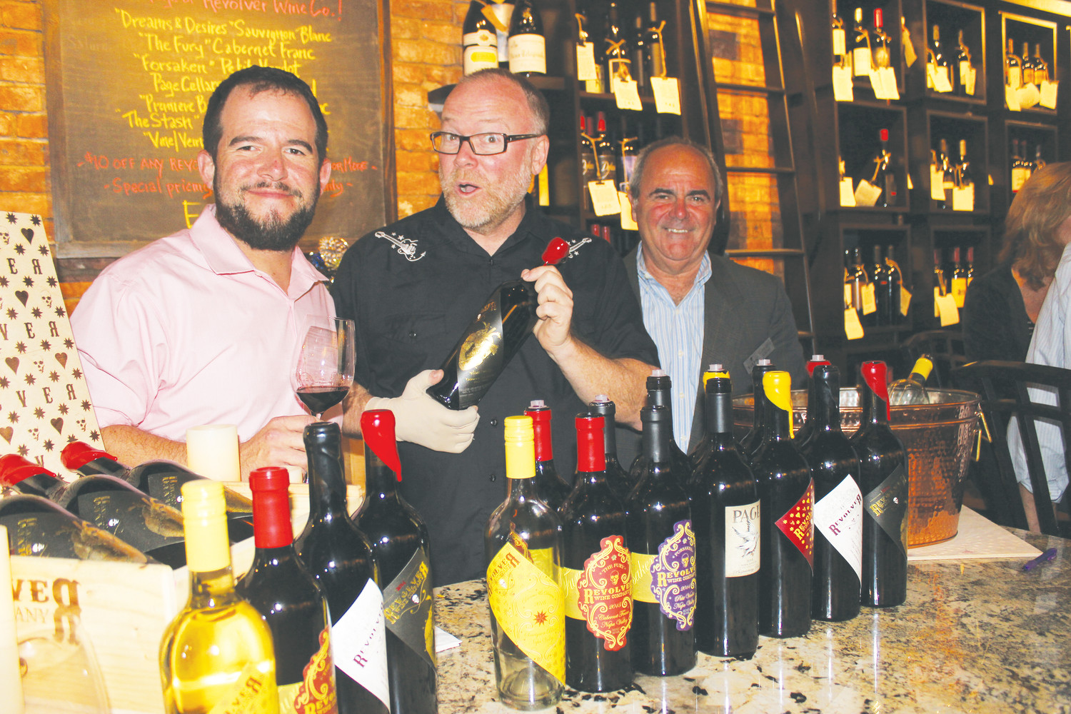 Coastal Wine Market & Tasting Room co-owner Steve Lourie, Bryan Page and Gonzalo Oliva