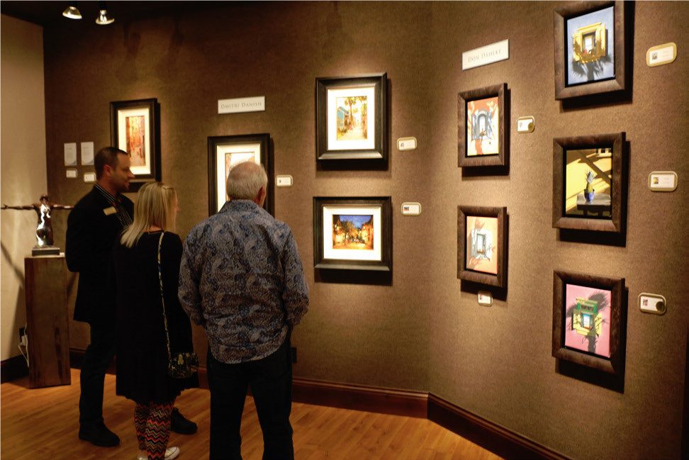Visitors enjoy Cutter & Cutter's Small Works Holiday Show in St. Augustine.