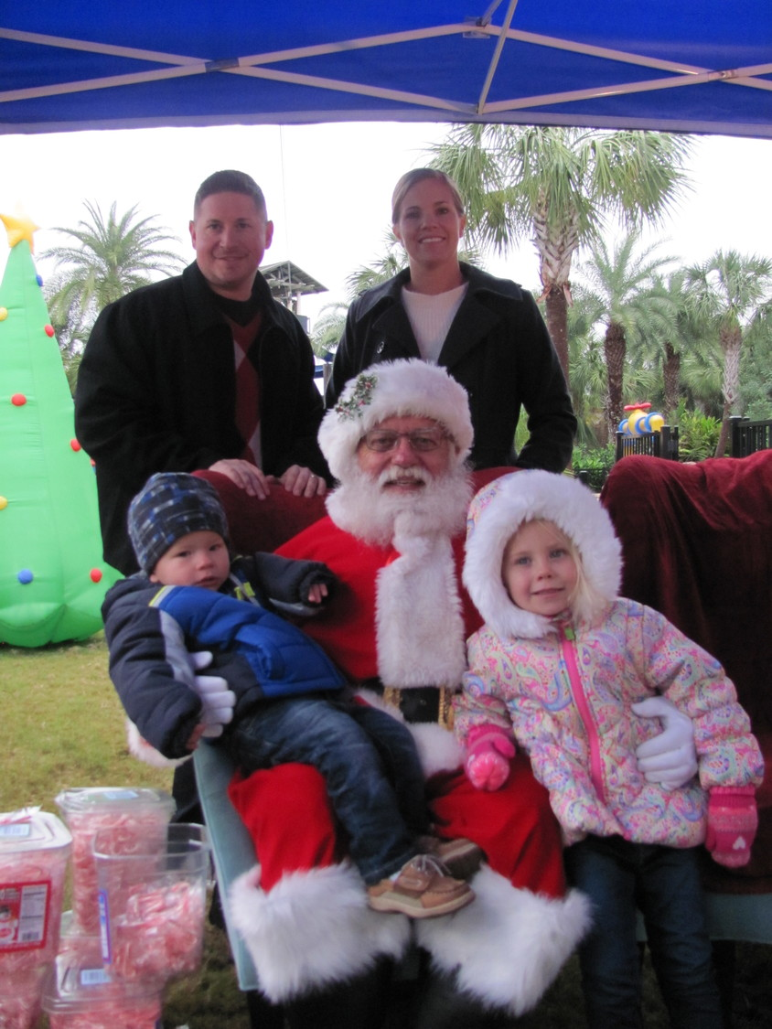 "Colton and Madison Naylor sit on Santa's lap with their parents Richard and Stephanie Naylor standing behind at Nocatee's ""Breakfast with Santa"" on Dec. 9."