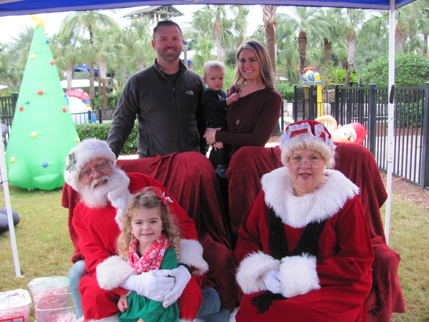 "Kendall Mcallister sits with Santa and Mrs. Claus at Nocatee's ""Breakfast with Santa"" on Dec. 9. Pictured behind them are parents David and Amy and brother Jackson."