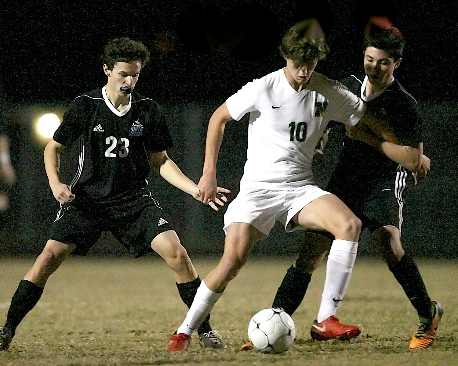 James Rossi (23) and Nico Gosendi (17) of the Sharks defend a Nease player.