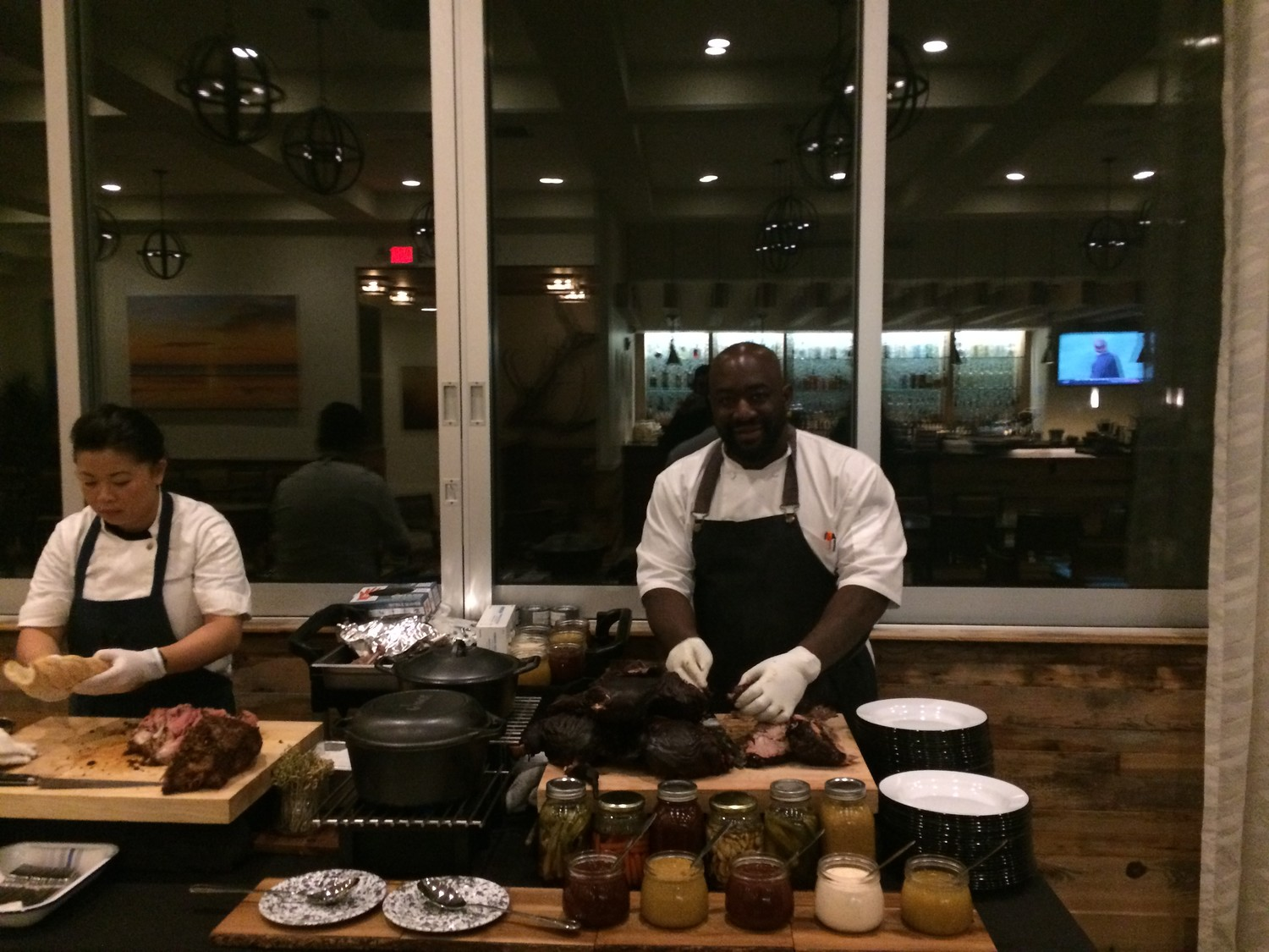 Chef Gilbert prepares a pork dinner at the Southern Kitchen opening preview event.