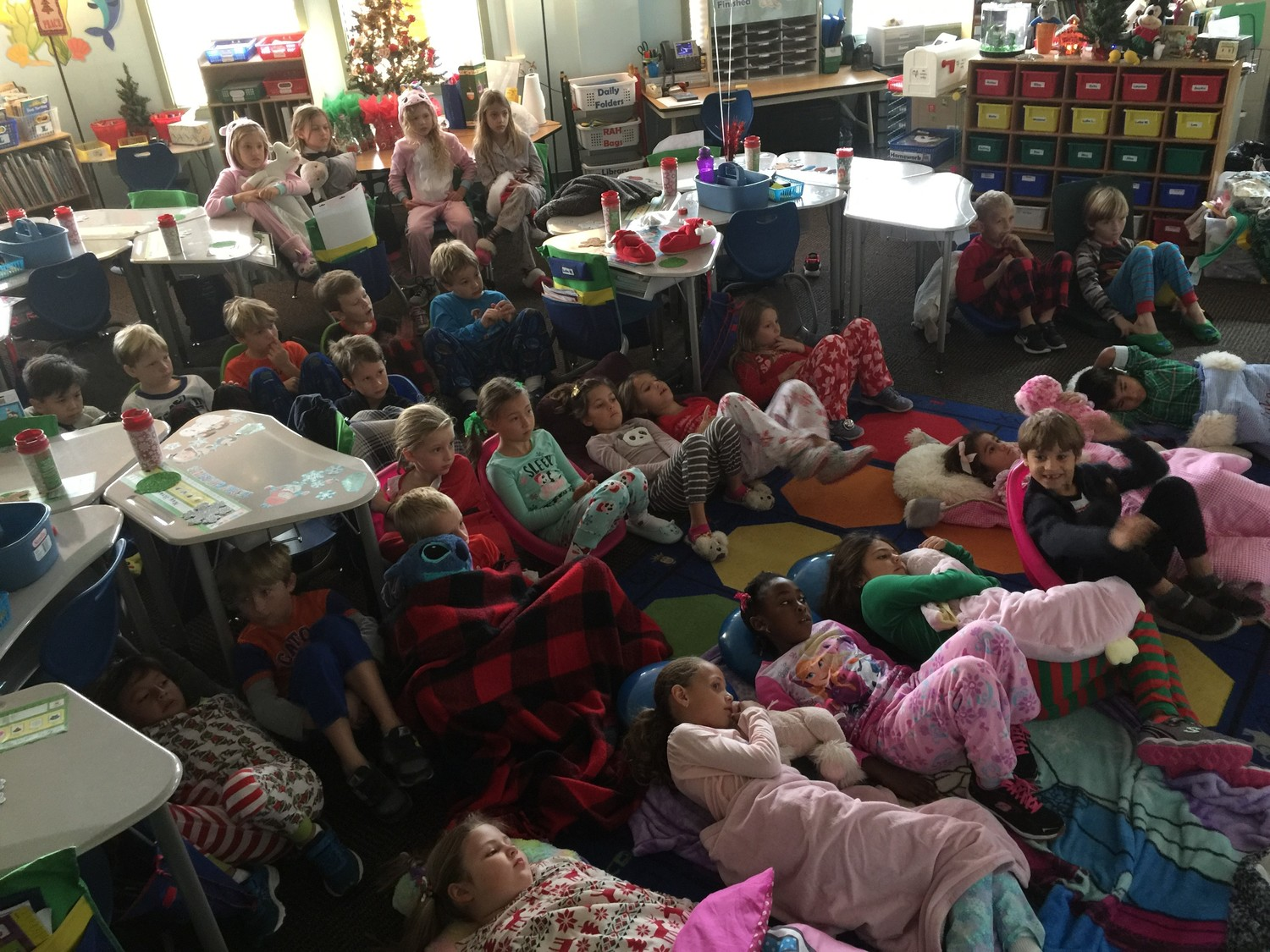 "First-grade students at Bolles Lower School PVB Campus enjoy a ""snow day,"" which included watching ""The Polar Express"" and a vocabulary-themed snowball fight."
