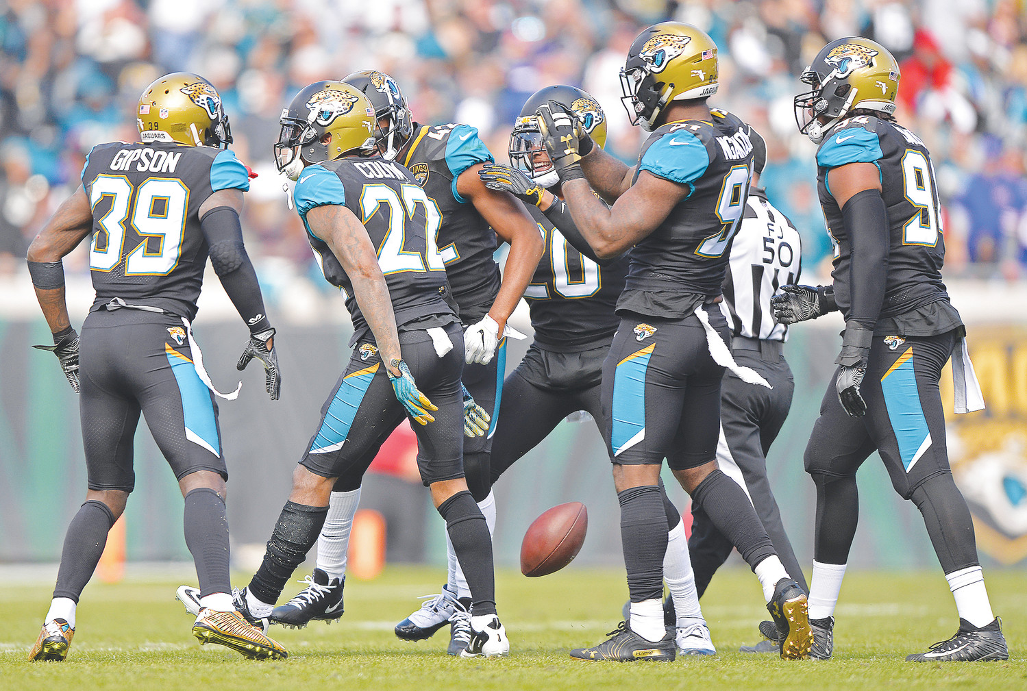 The Jaguars' defense celebrates a big play during the wildcard win against the Bills.
