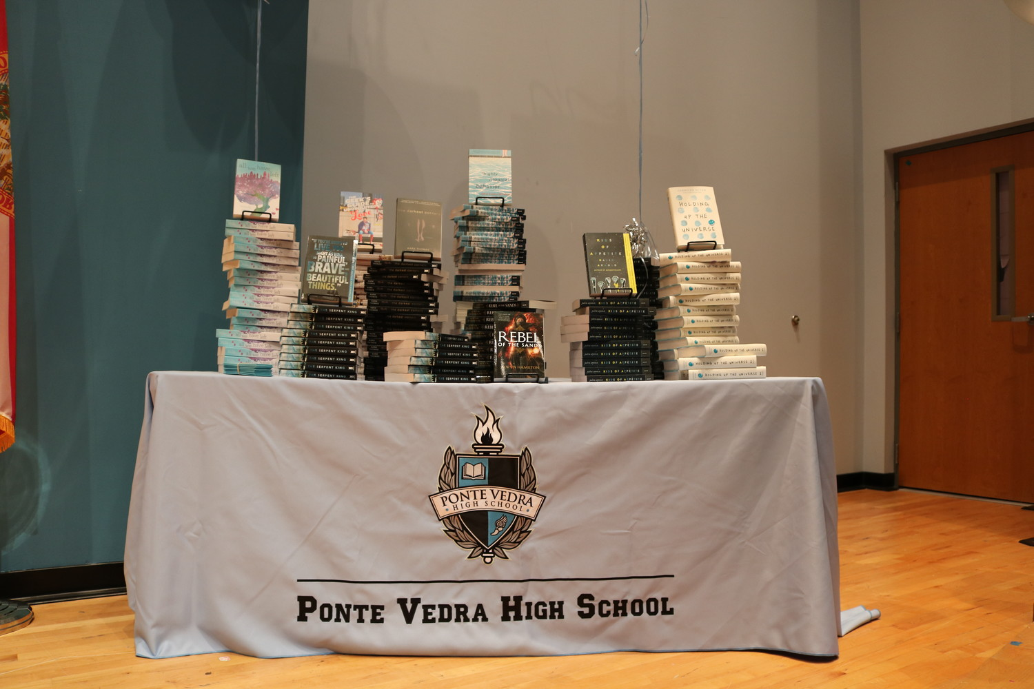 A stand featuring books available for Ponte Vedra High School students at the school library.