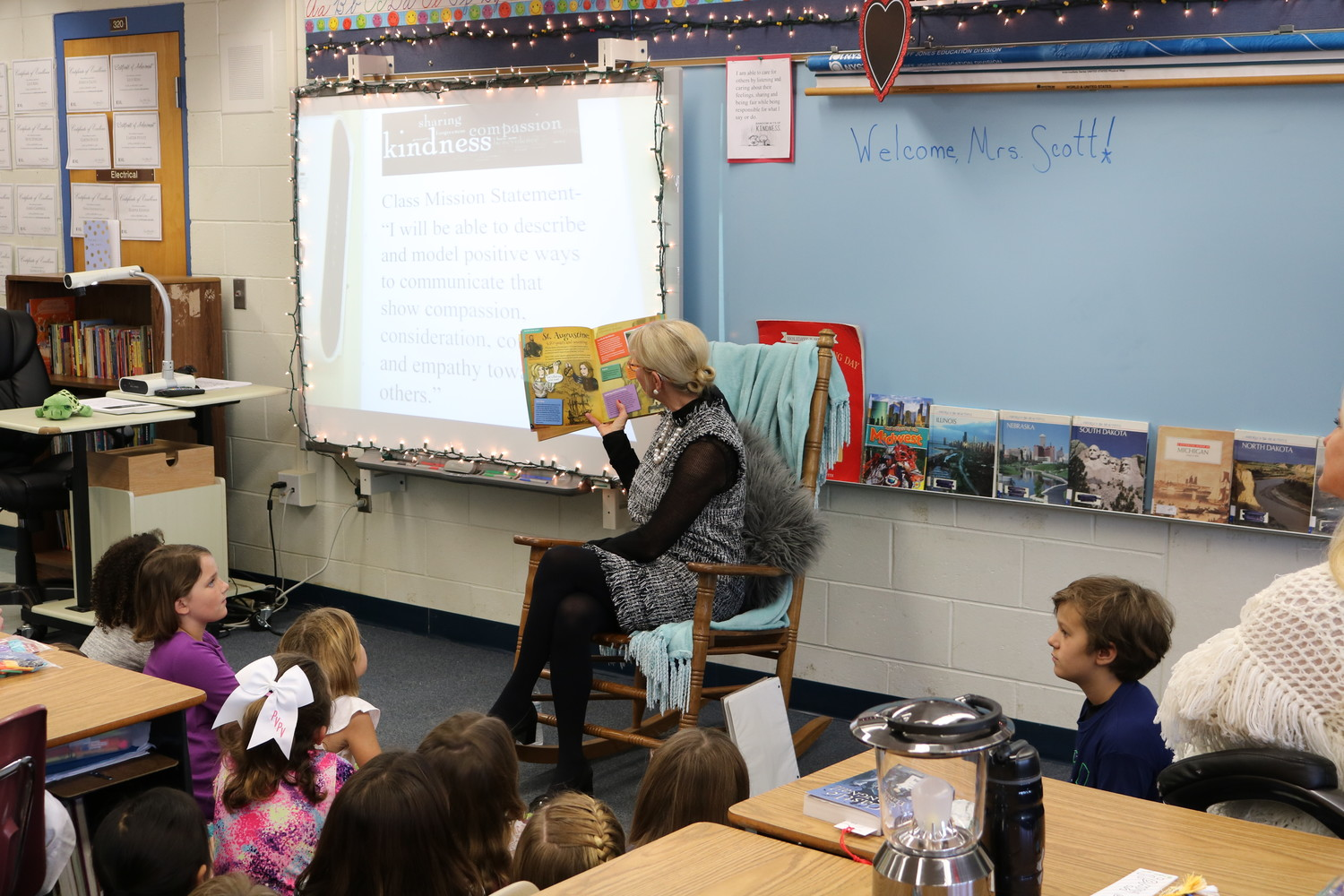 First Lady Ann Scott reads a story to PVPV-Rawlings Elementary School students as part of her literacy tour.