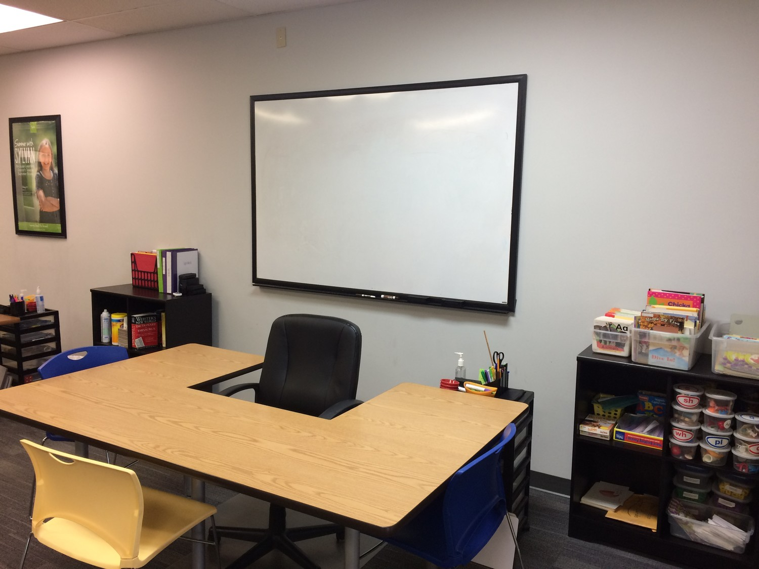 A whiteboard, desk and chair creates a classroom atmosphere at Sylvan Learning Center.