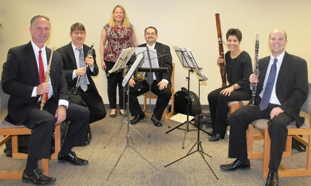 The woodwind quintet of the Jacksonville Symphony is displayed from from left to right: Les Roettges (flute), Eric Olson (oboe), Anne Crawford of the library, Kevin Reid (French horn), Stephanie Magnus (bassoon) and Patrick Graham (clarinet).