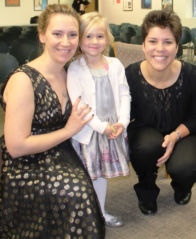 A mother and daughter gather with Stephanie Magnus from the Jacksonville Symphony at the Musical Madness for Kids event Jan. 24 at the Ponte Vedra Beach Branch Library.