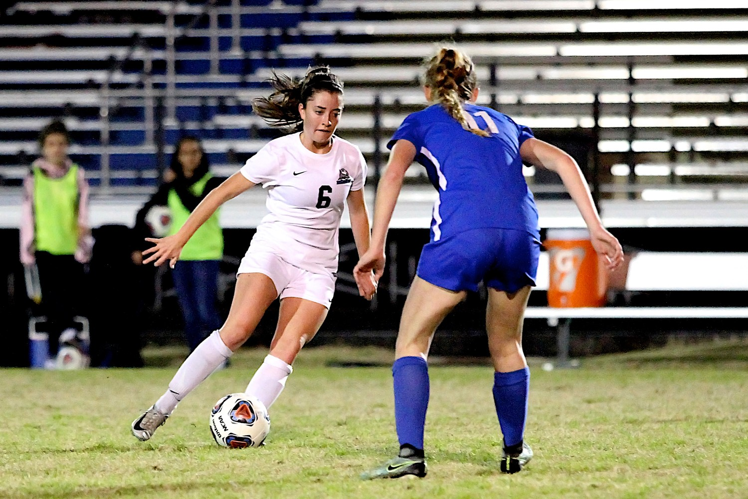 Molly Miler of the Sharks moves the ball past a Pedro defender.