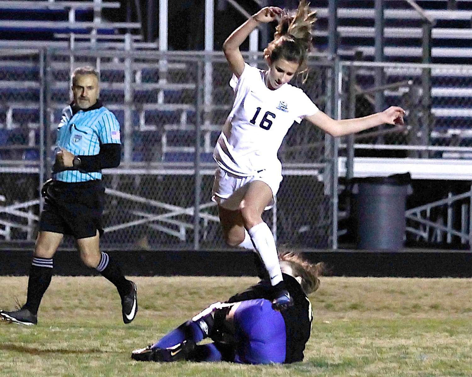 Julia Deal (16) of Ponte Vedra leaps over the Falcons' goalkeeper.
