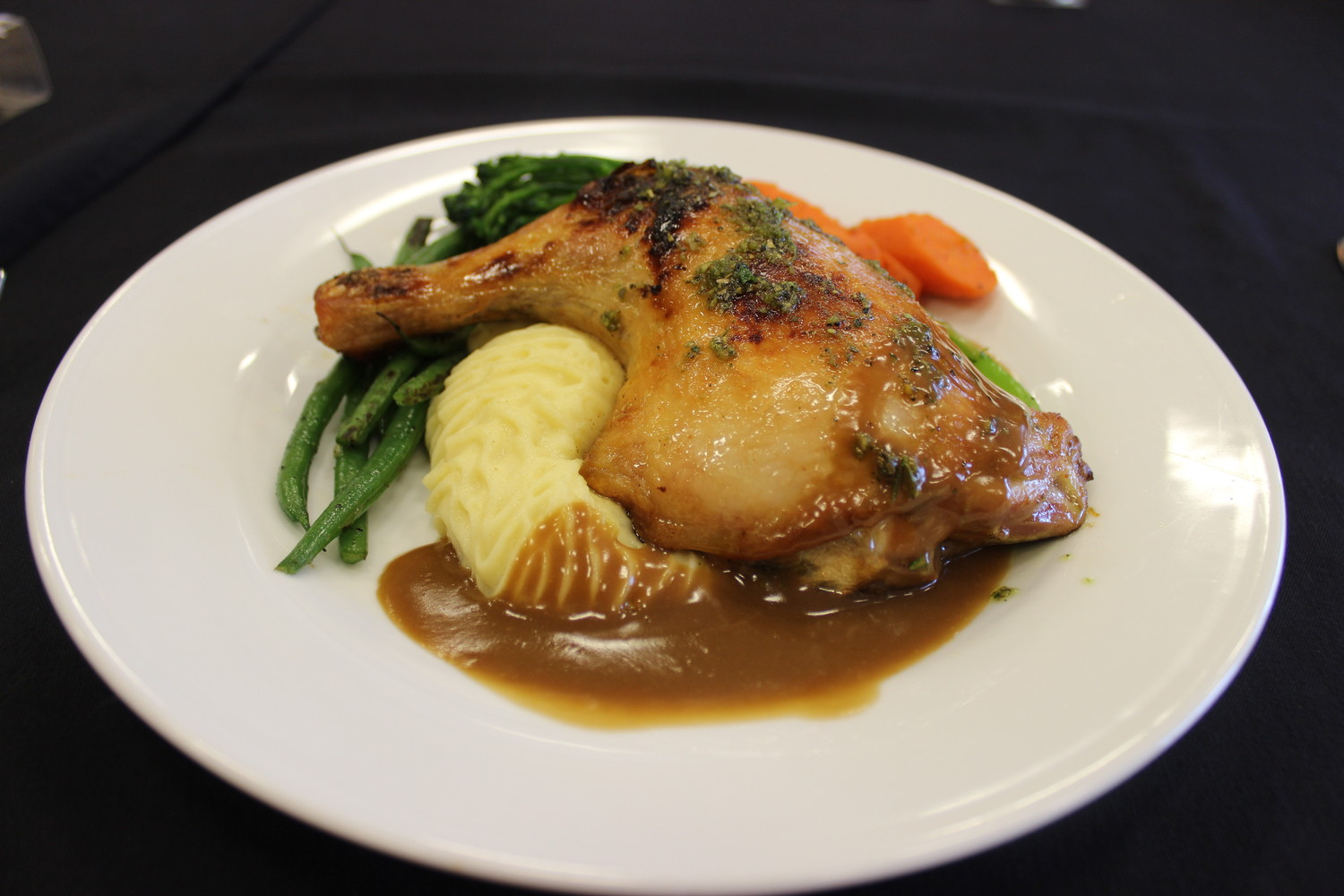 Roasted herb chicken with butter-whipped potatoes and sautéed root vegetables in a veal Brandywine demi glaze, which is an example of the cuisine Sawgrass Events can provide its customers.