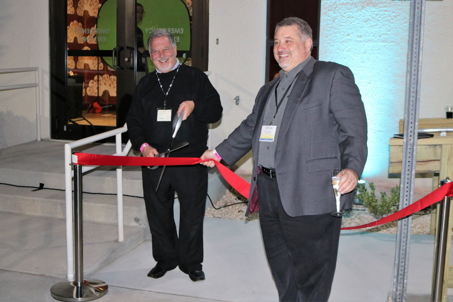 Friends of the Ponte Vedra Concert Hall President Steve Gard (left) and Director Marc Ressler cut the ribbon for the outdoor deck.