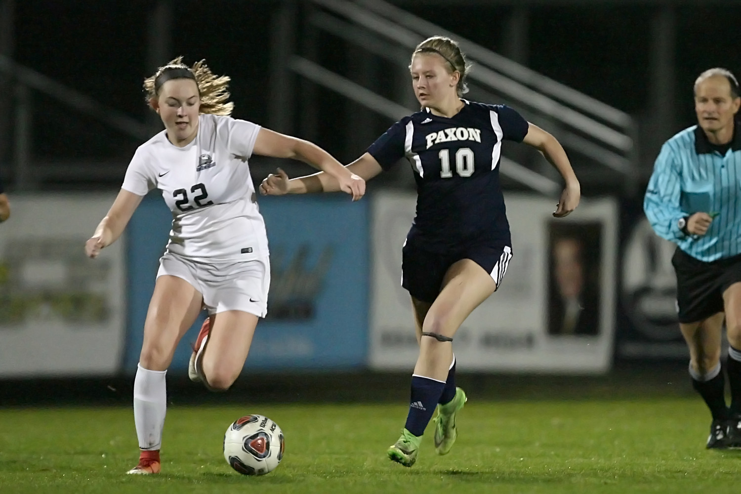Reilly Tarbet (22) has good position as she battles the Paxon player for control of the ball.