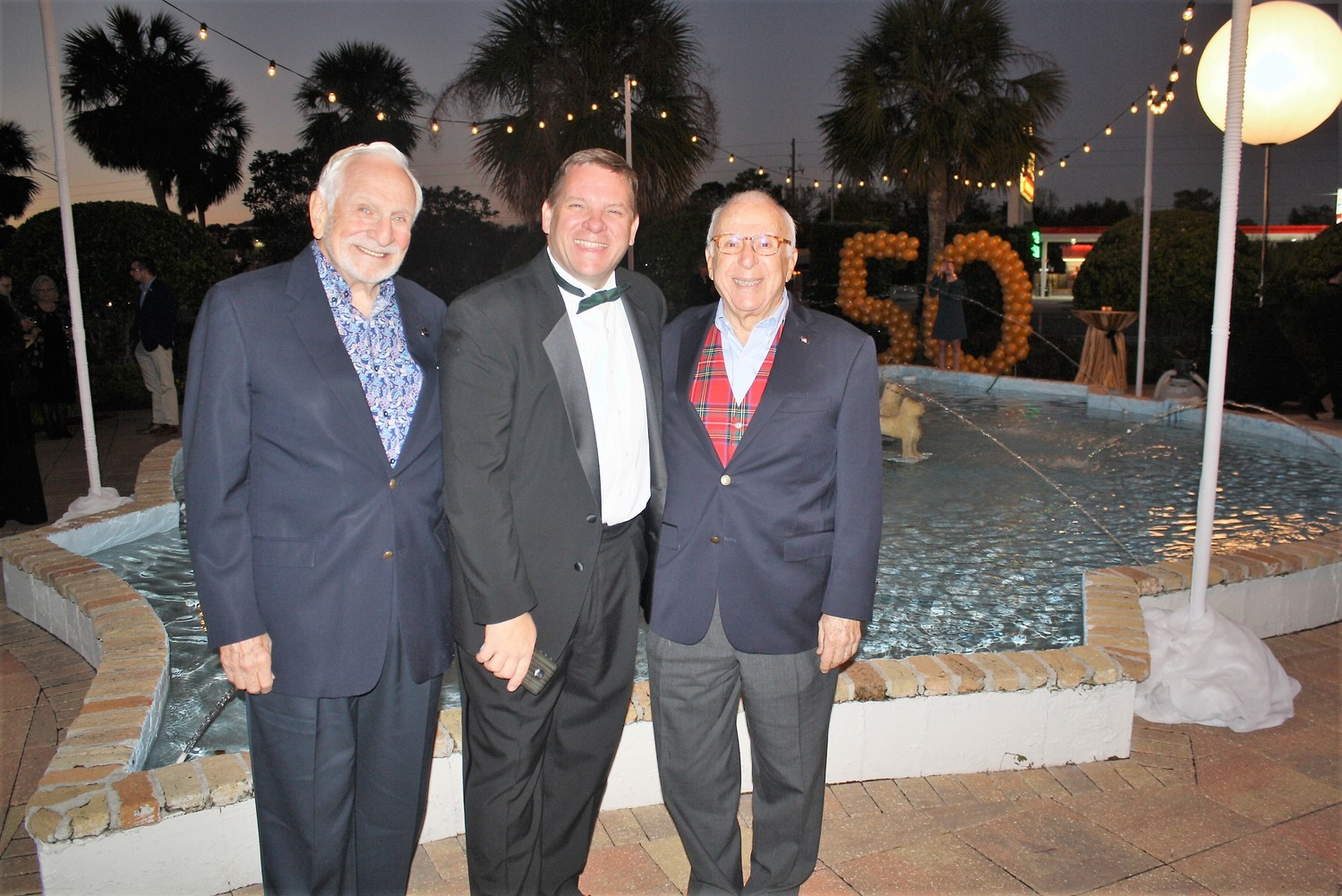 Alhambra Managing Partner Craig Smith (center) stands with former Alhambra owner Ted Johnson (right) and Barry Zisser (left).
