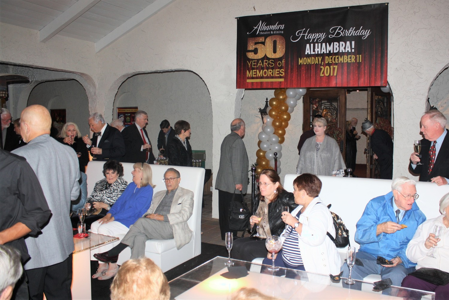 Alhambra patrons sip cocktails and champagne as they celebrate the dinner theatre's 50th anniversary.