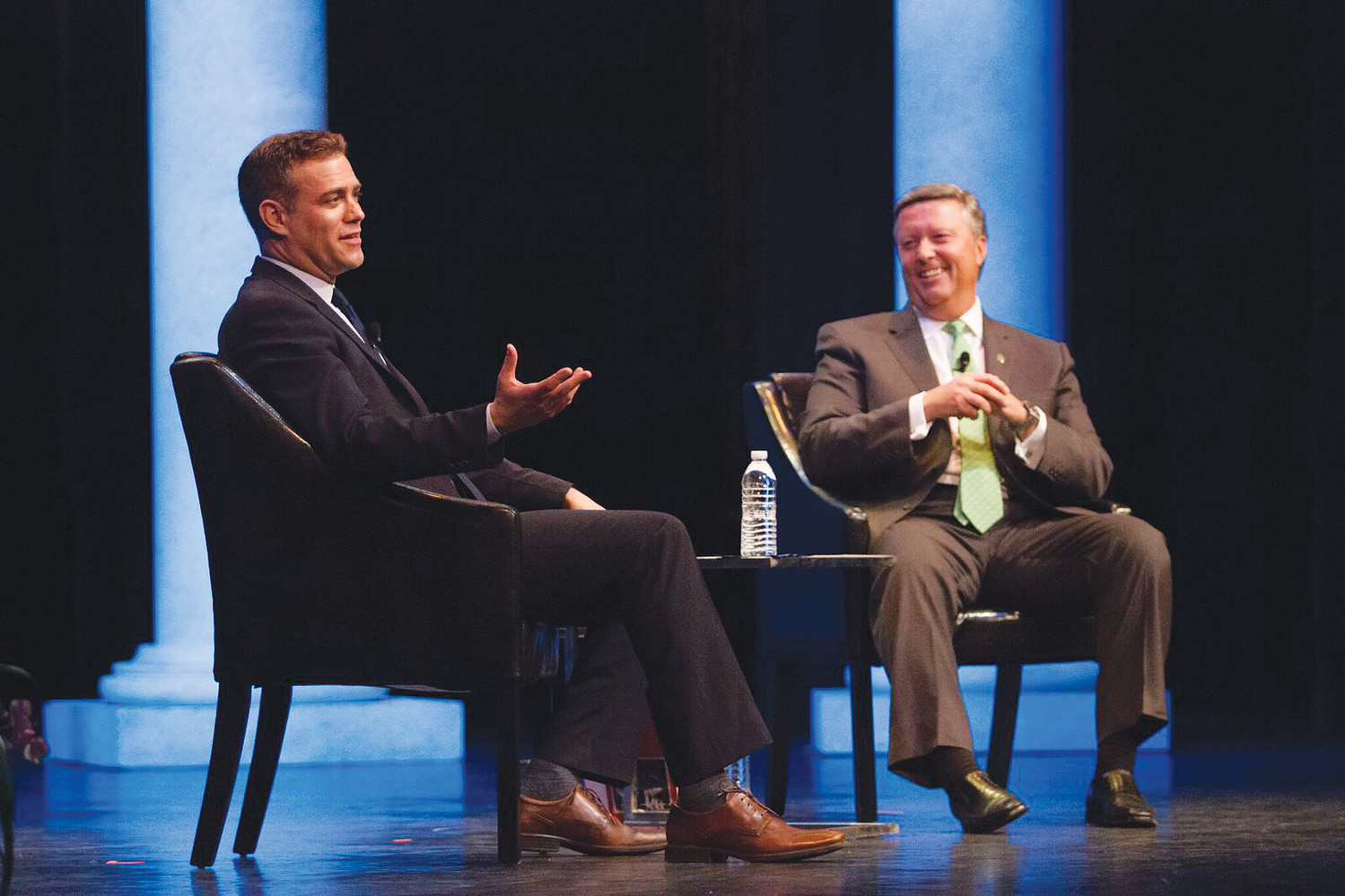 Chicago Cubs President of Baseball Operations Theo Epstein chats with Jacksonville University President Tim Cost at Epstein's Florida Forum address Jan. 16 at the Times-Union Center for the Performing Arts.