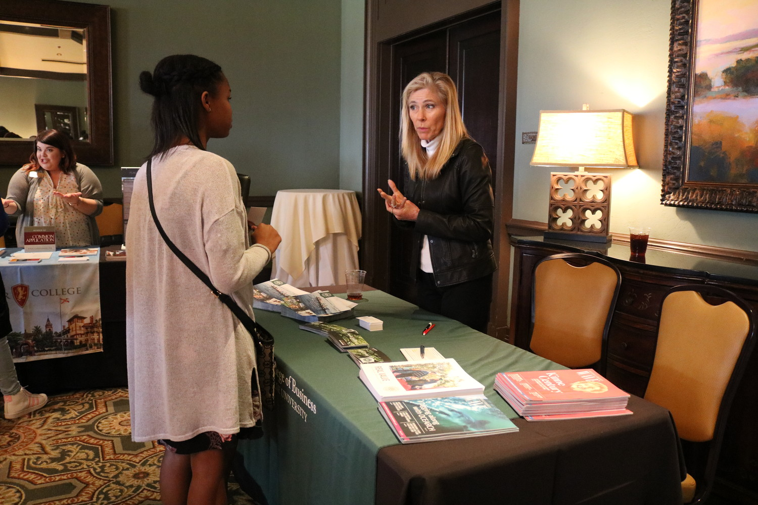 A student talking with a vendor about career opportunities.