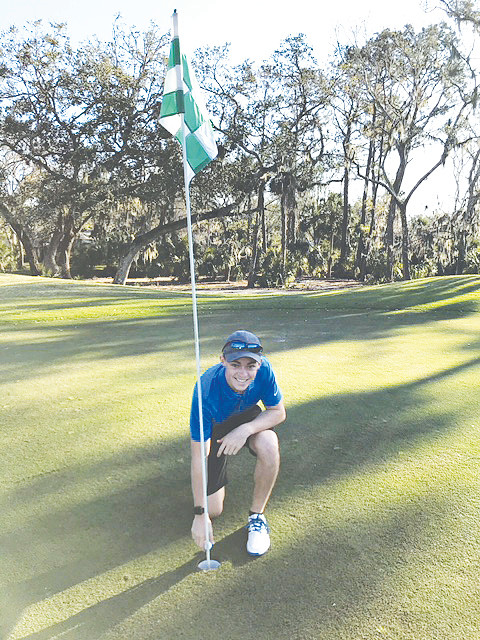 Matthew Quintal celebrates making a hole-in-one at No. 8 at Oak Bridge Club on Sunday, Feb. 17. Quintal played with clubs that once belonged to his uncle, who recently passed away due to cancer. Quintal and his uncle frequently played golf together before his passing.