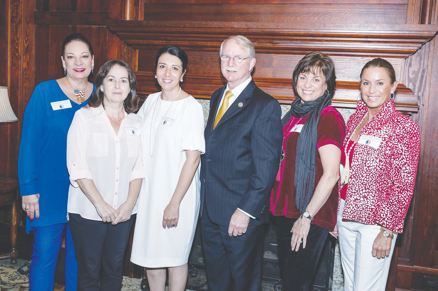Rep. John Rutherford (center) gathers with event organizers Kristie Pape, Flavia Bowling, Francesca Rutherford, Helen Lateau and Tracie Rampley