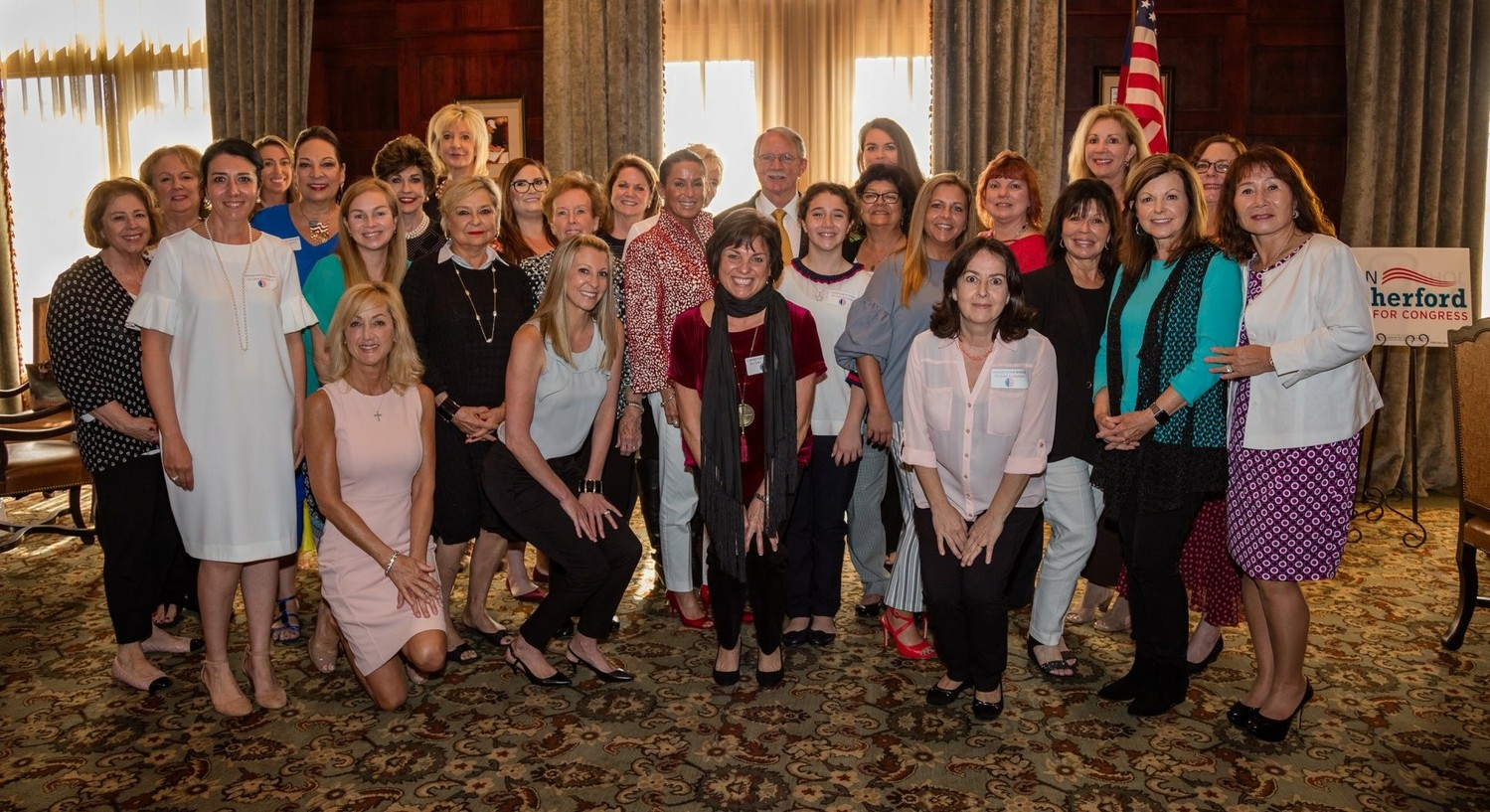 Rutherford gathers with several of the women in attendance of the event.