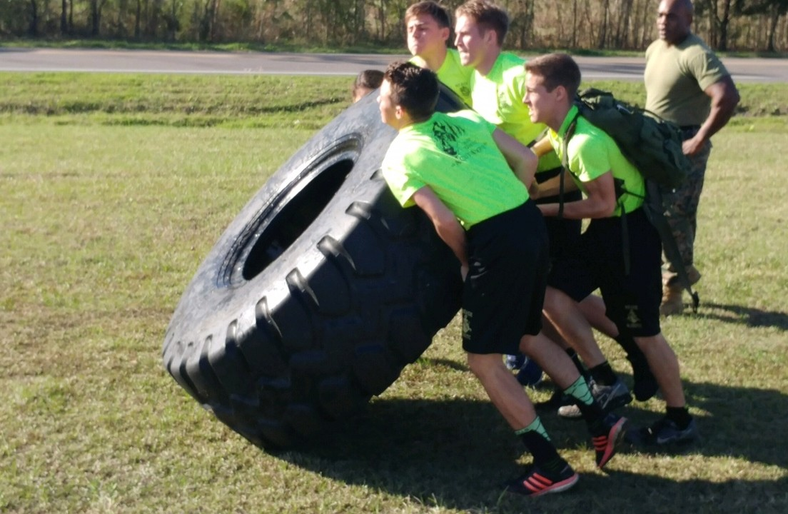 Nease NJROTC competes in the tire flip competition.