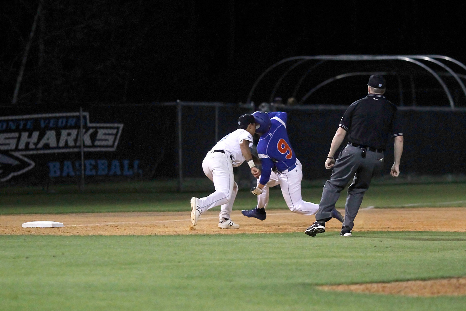 Sharks third baseman Sebastian Rothman tags the Bolles runner attempting to reach third on a base hit.