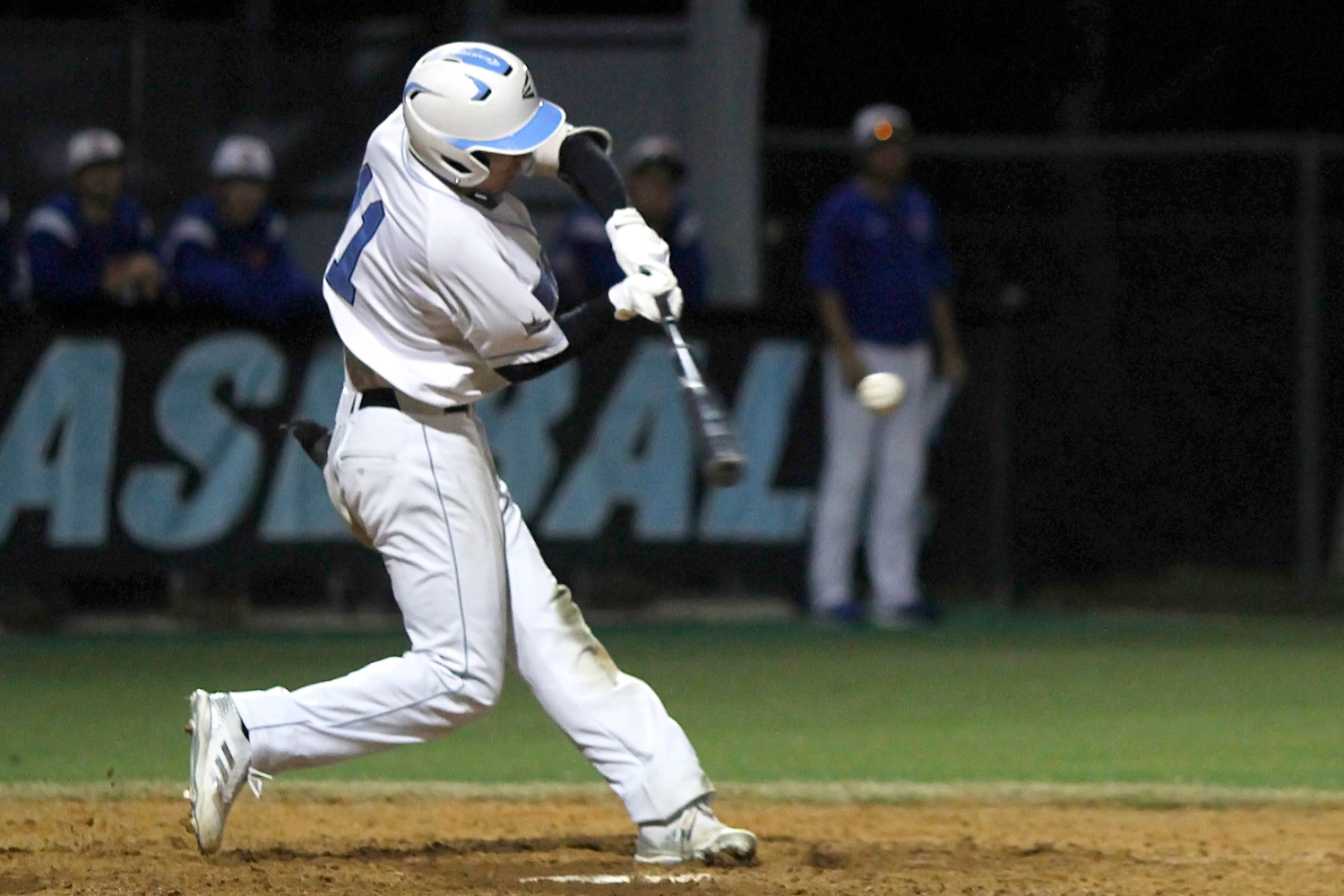 Jacob Young hits a double, one of his two hits against Bolles.