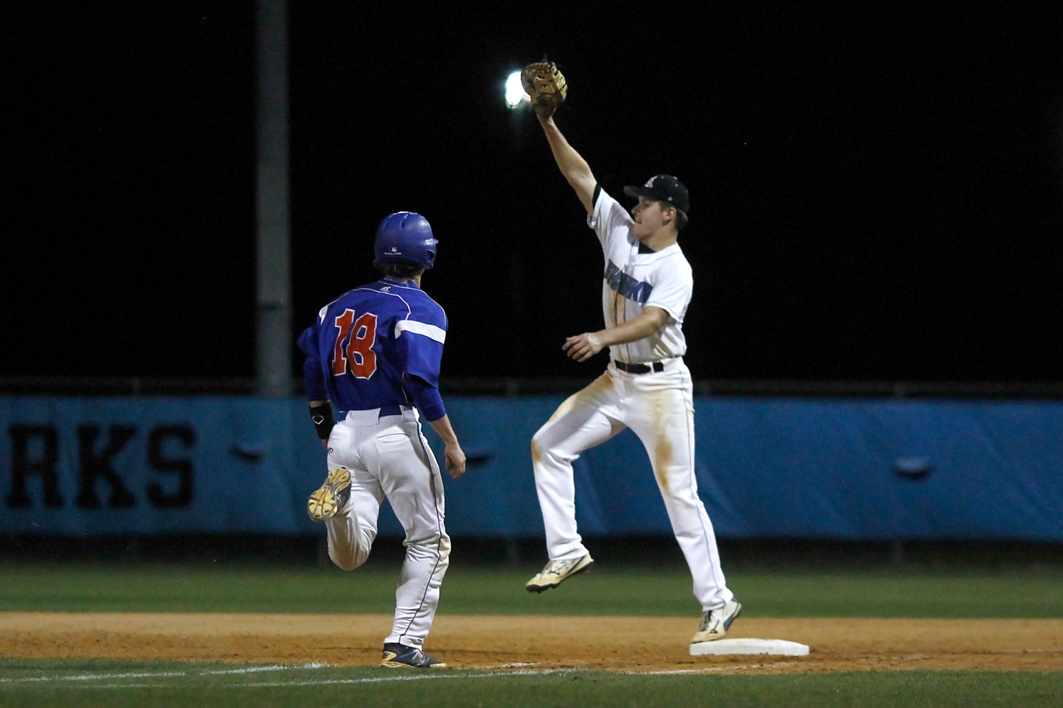 Sharks first baseman Tony Roca stretches high to retire the Bolles batter.
