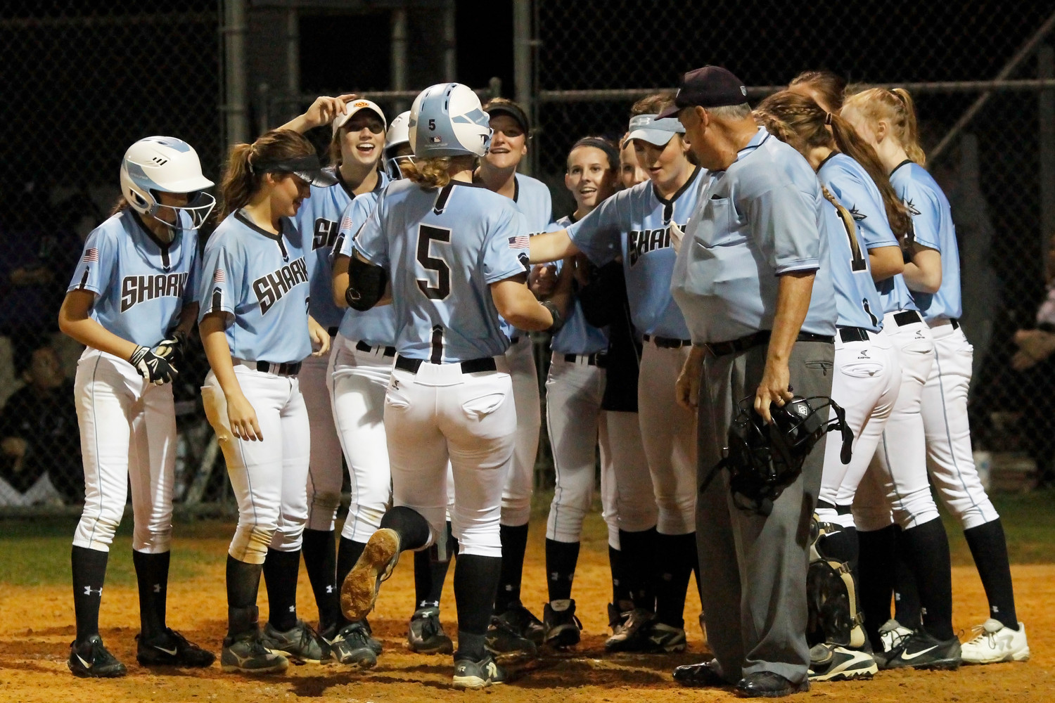 The Ponte Vedra softball team celebrates Michelle Holder's home run in the fifth inning.