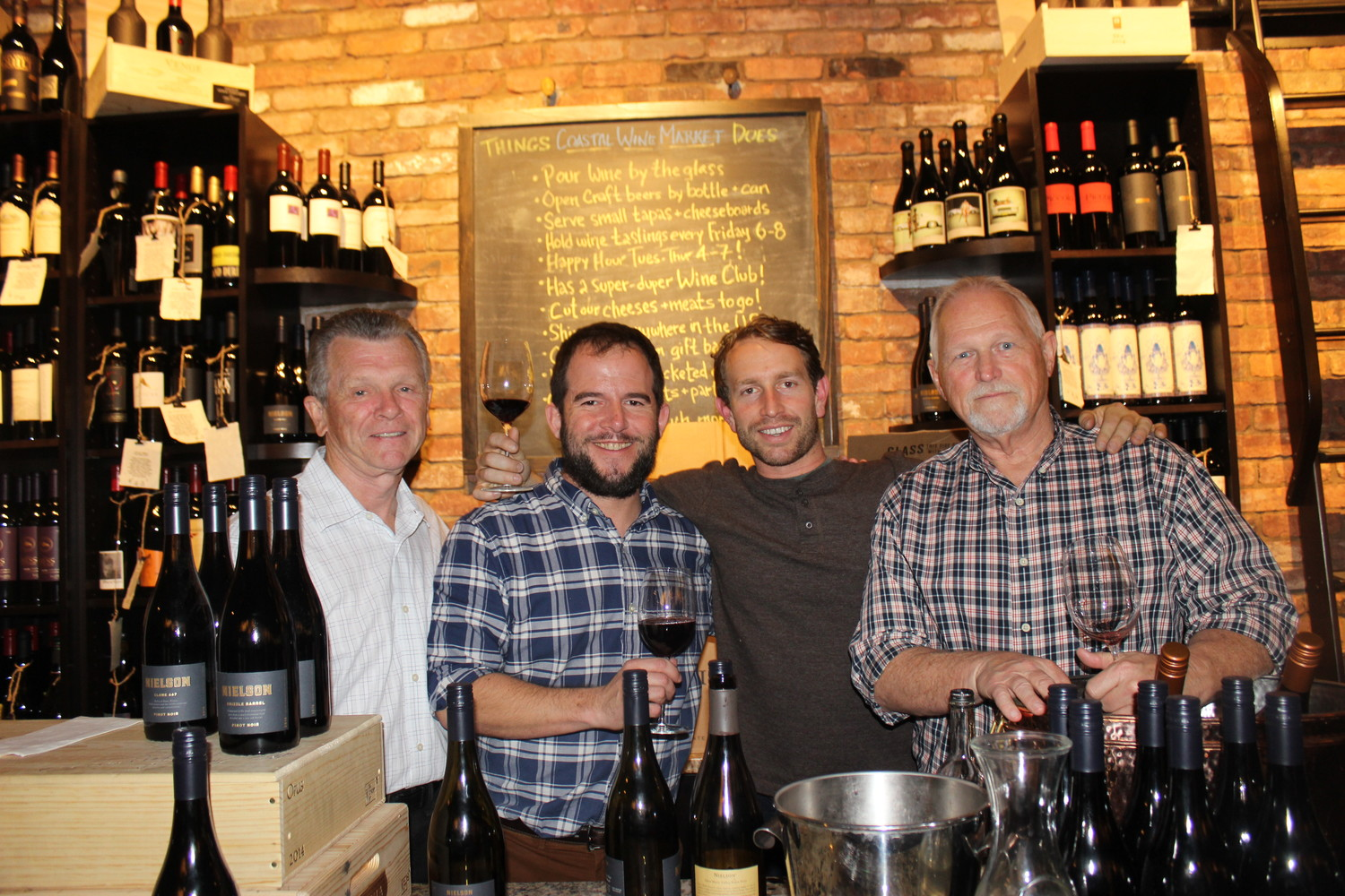 "Dennis Mahoney, Steve Lourie, Ryan Pace and Allen Horne gather at the ""Meet The Winemaker event"" at Coastal Wine Market & Tasting Room on Thursday, March 22."