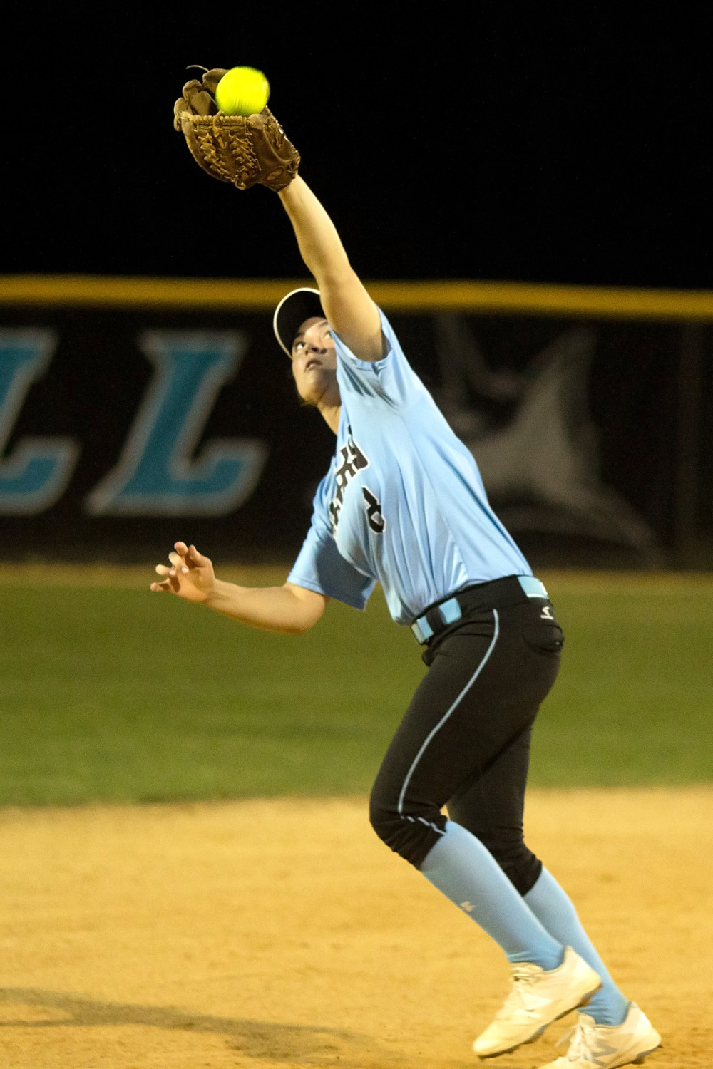 Shark shortstop Michelle Leone catches up to a short fly ball.