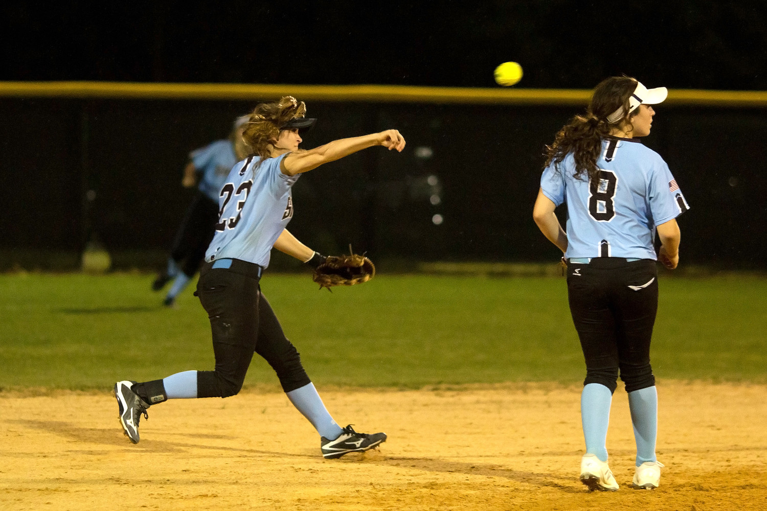 Kiley Hennessey makes the throw to first on a ground ball.