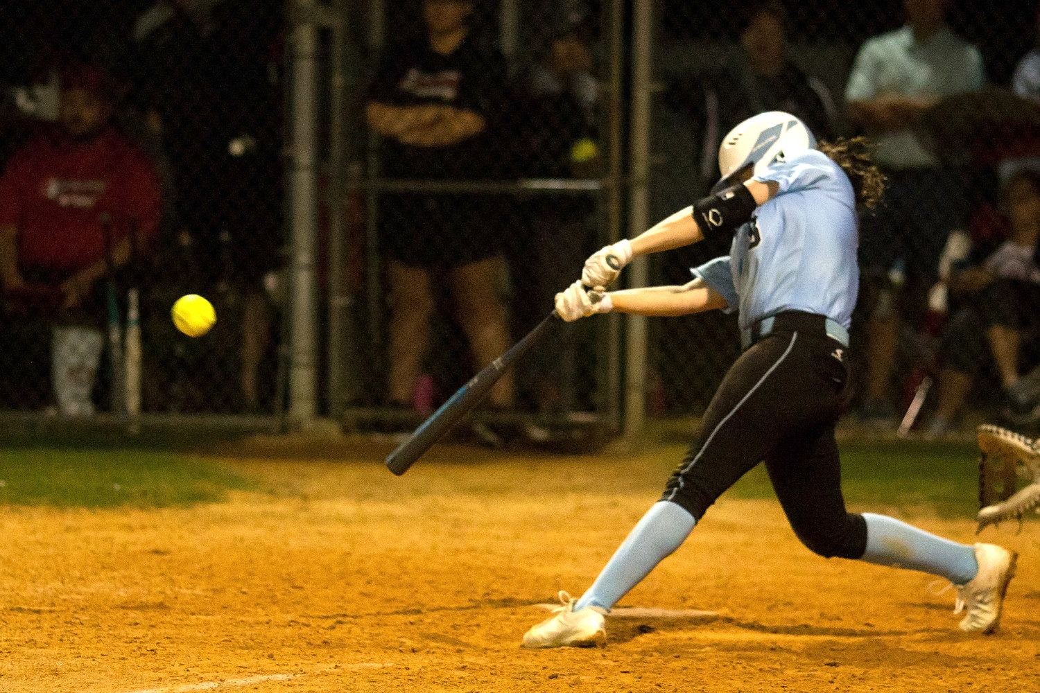 Michelle Leone delivers a base hit to drive in the Sharks only run