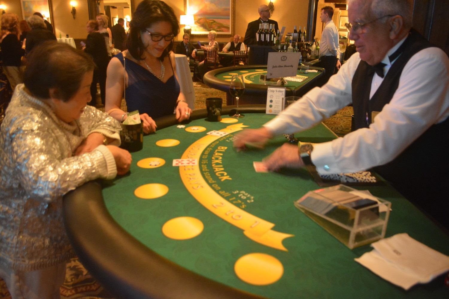 Guests enjoy the blackjack table at the Aylas Acre's Casino Night on the Greens.