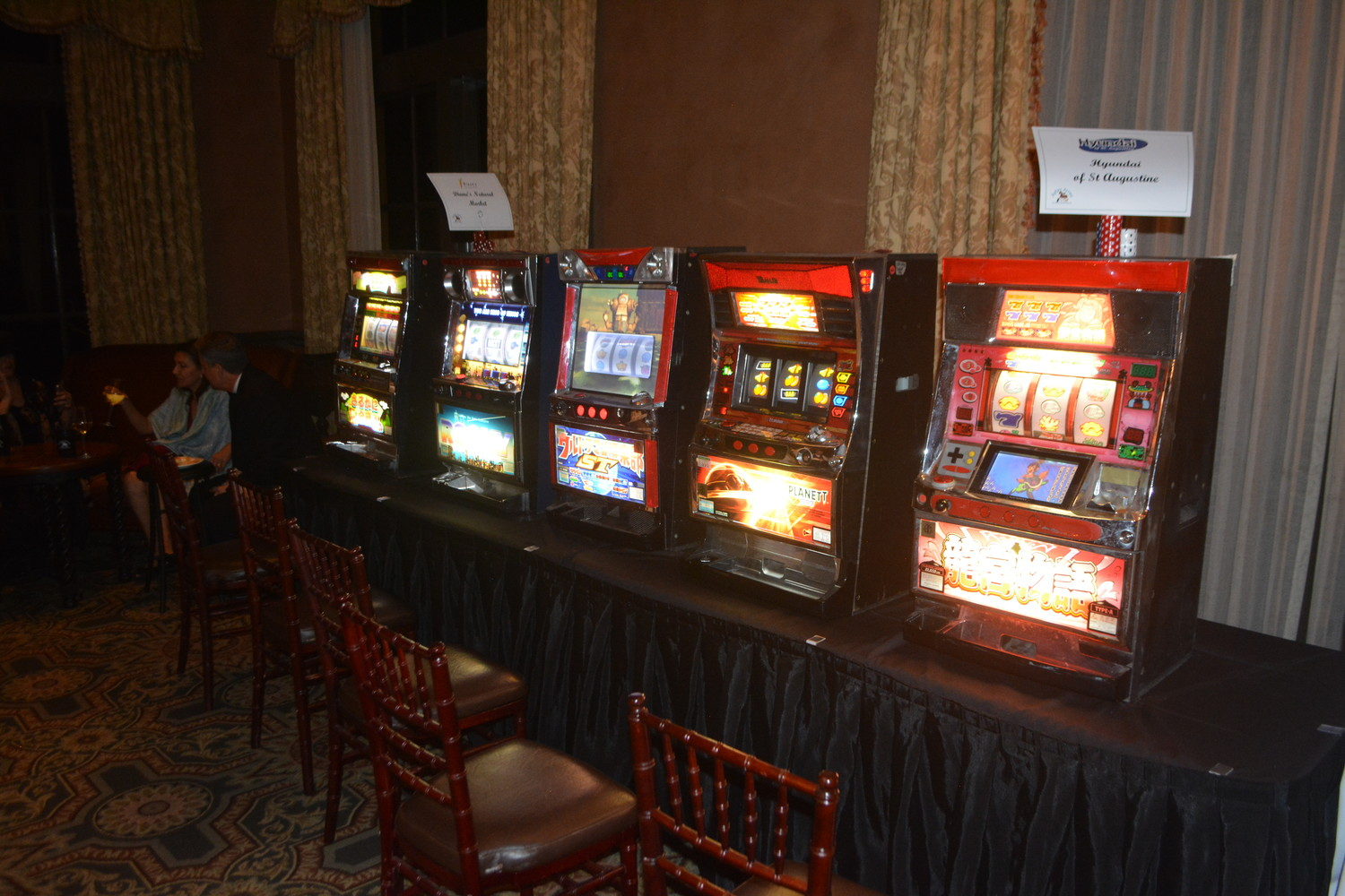 The slot machines at the Casino Night on the Greens event