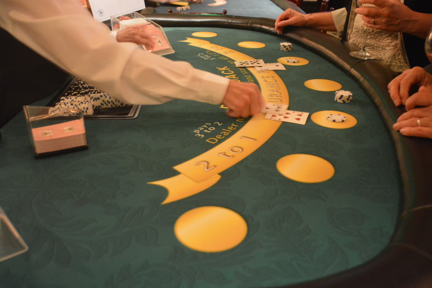 Attendees play cards at Casino Night on the Greens.
