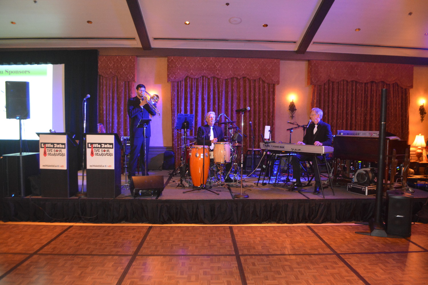 Little Jake & The Soul Searchers provide Casino Night on the Greens attendees with live music and entertainment.