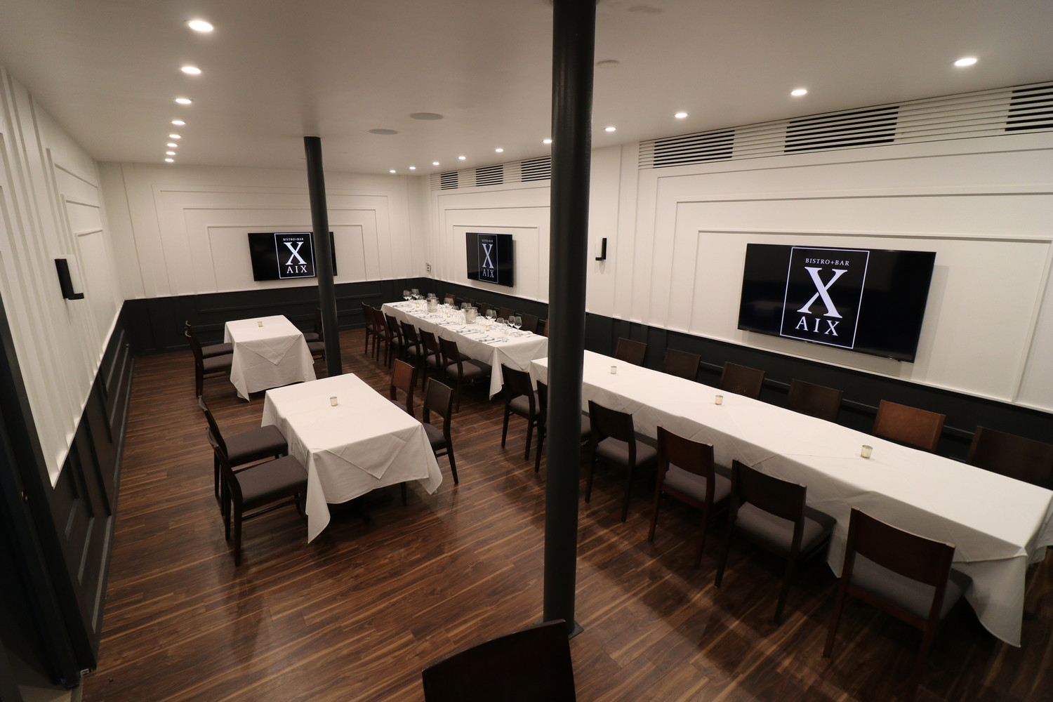 Bistro Aix now features a lighter and more refreshed design, as seen in the floors, curtains, chairs and tables.