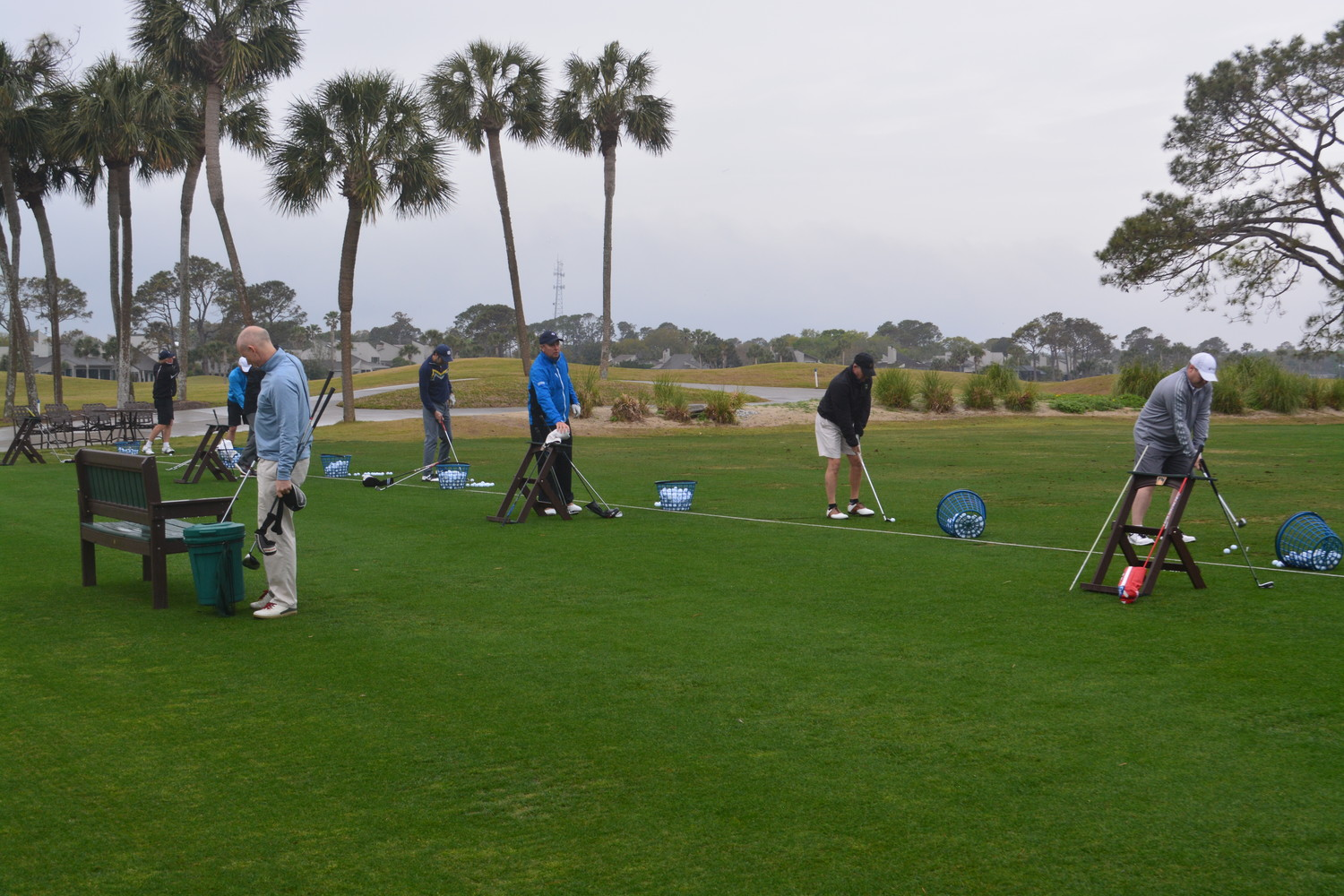 Golf tournament participants take a few practice shots at Sawgrass Country Club before the action begins.