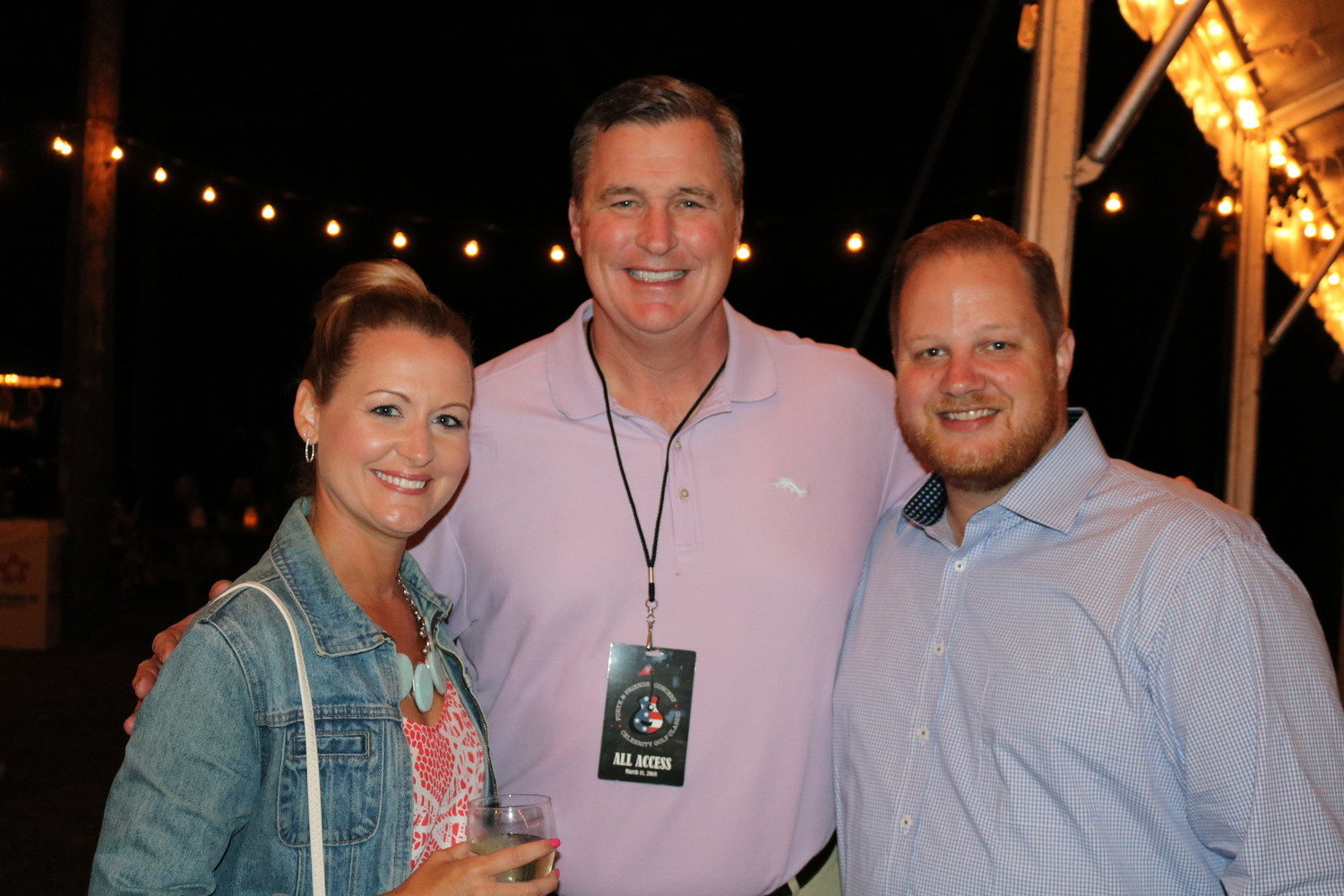 Janelle and Josh Zenner with Jaguars coach Doug Marrone before the concert