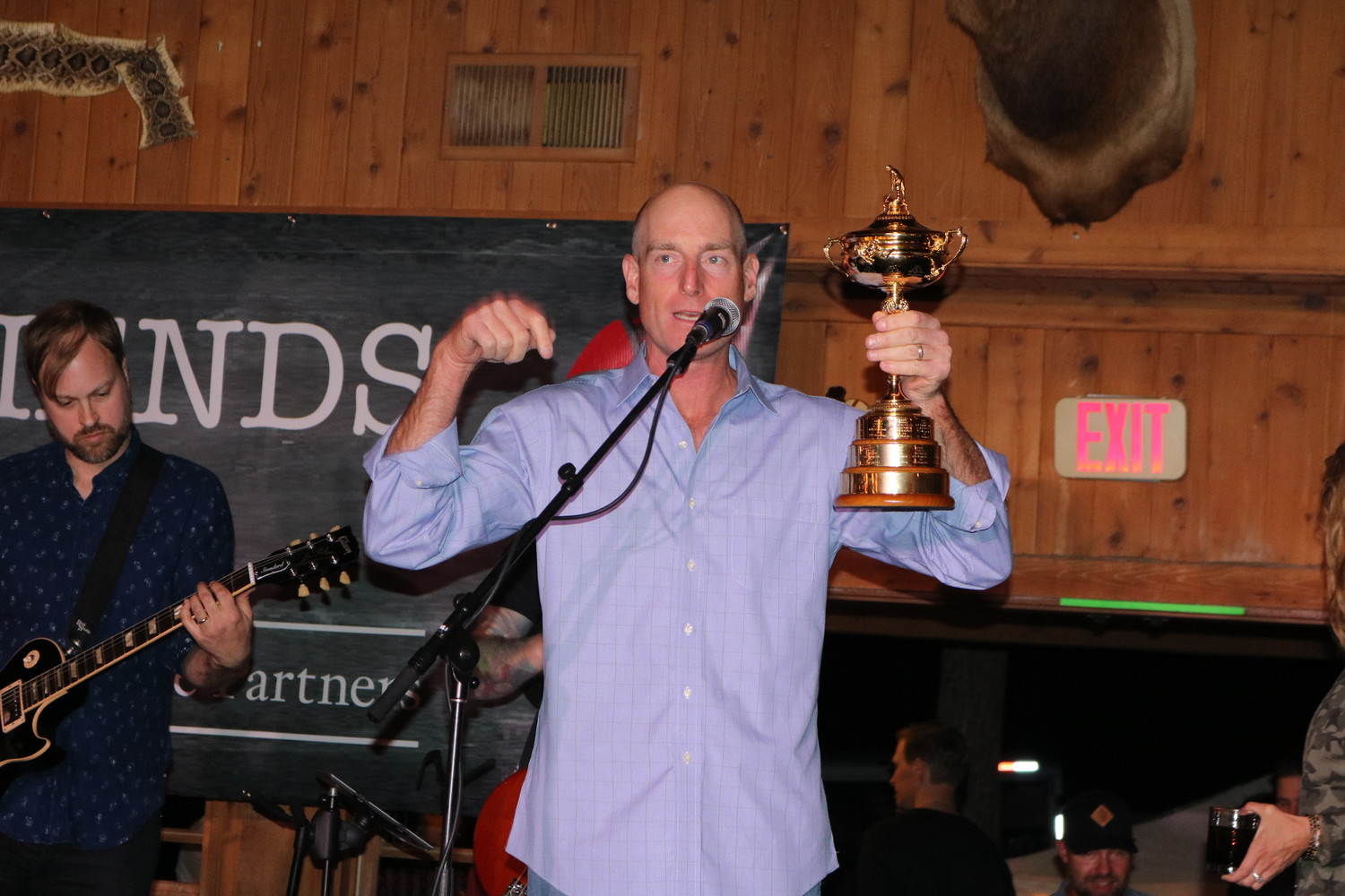 Jim Furyk addresses the attendees of the concert with the Ryder Cup trophy in hand.