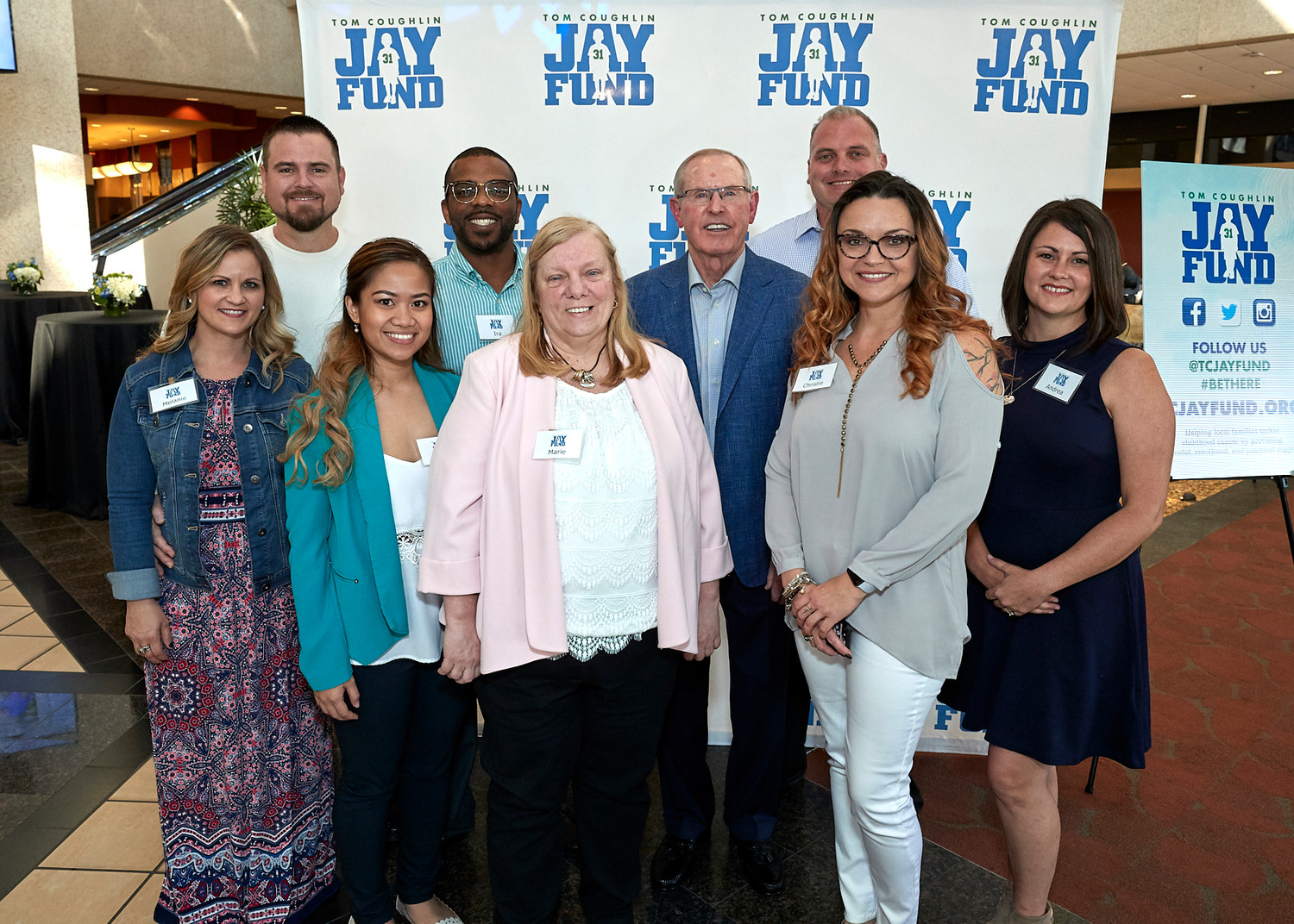 Tom Coughlin gathers with the evening's VIP hosts, who are Jay Fund families whose child has tackled or is tackling cancer.