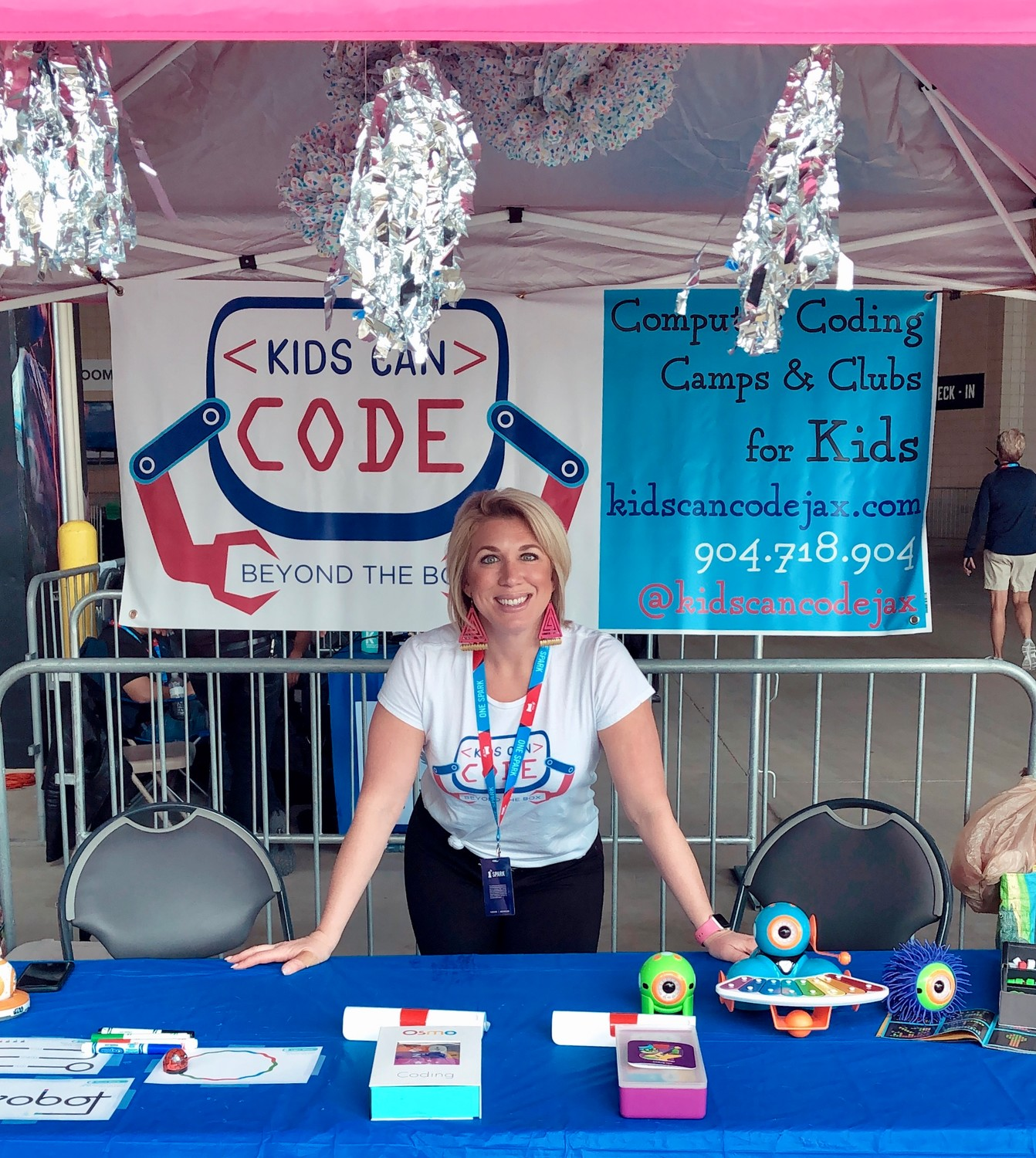 Ocean Palms Elementary School teacher Lauren Wade stands in front of her Kids Can Code booth at the One Spark idea festival at EverBank Field, where she ultimately took home third place and a $5,000 reward after competing in the Spark Tank competition.