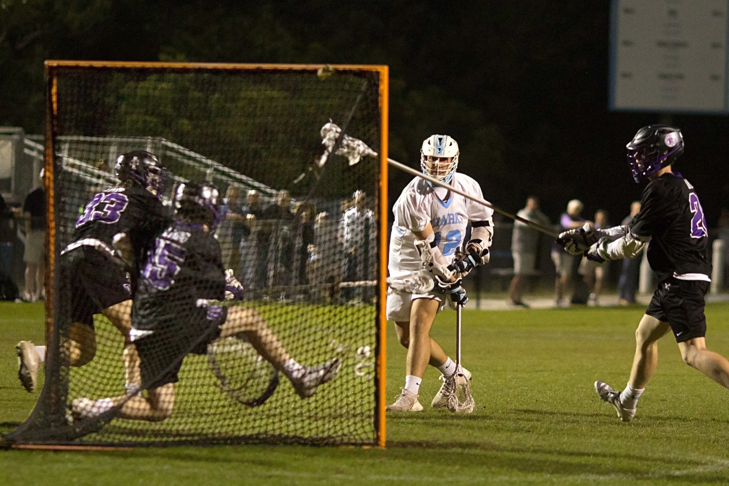 Walker Azzaro of the Sharks fires a low shot that is blocked by the Gonzaga goalie.