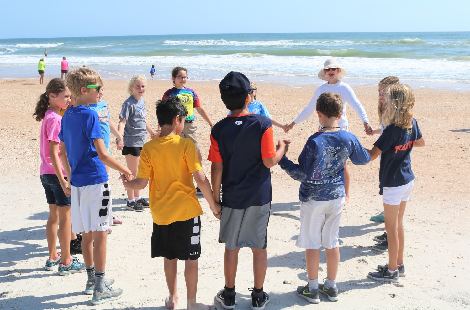 Children Pare In A Wave Motion Activity After Story Time