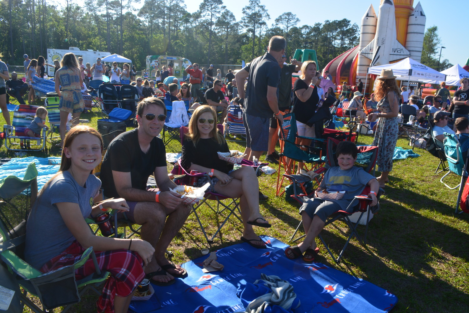 Todd and Mandy Kowalski take in the Roscolusa Songwriters Festival with their children.