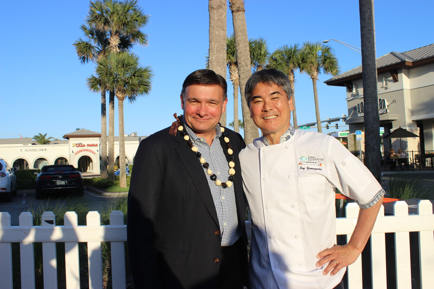 John Crawford and Roy Yamaguchi gather at a Night at Roy's, which was held Wednesday, May 2, at Roy's Restaurant in Jacksonville Beach.